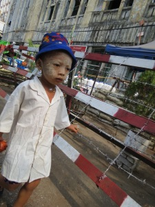 Little boy wearing thanaka